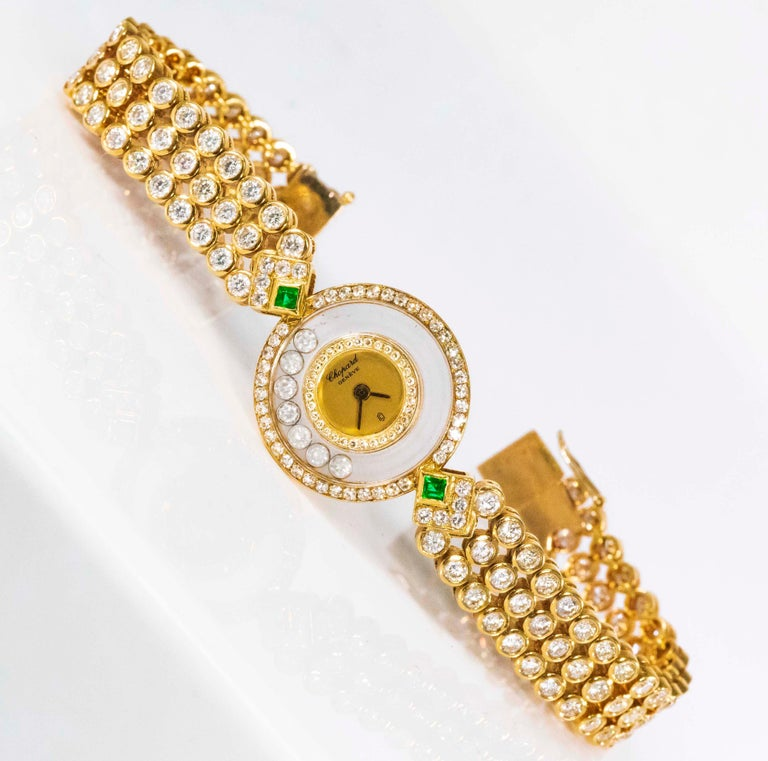 A 1980s Happy Diamond Chopard Piece Unique 18kt Yellow Gold Emerald Three Row 20 carat Diamond Set Bracelet Watch  Case Dimensions & Basic Overview  *22mm across  x 22mm top to bottom *Fully Signed, Recently serviced & Perfect Working