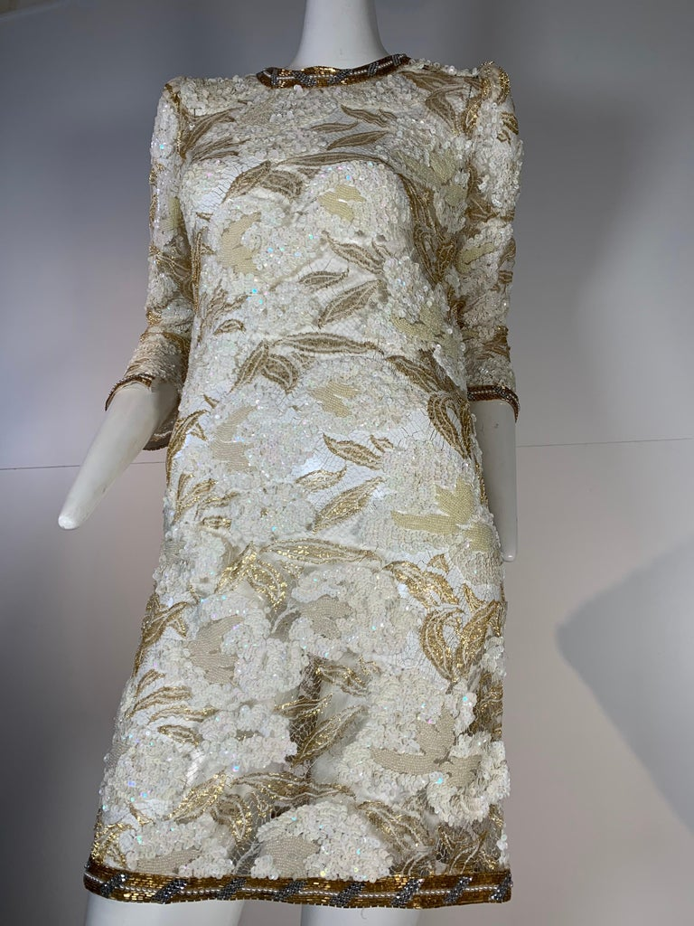 Early 1980s Adolfo sequined and beaded gold lace 3/4 sleeve mini dress with pouf shoulder.  Gold bead banding at hem, collar and cuff. Back zipper. Unlined.