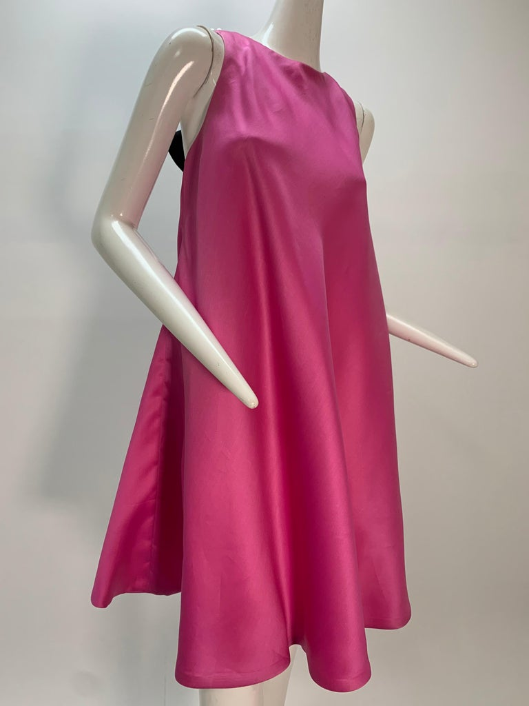 1980s Bill Blass bias-cut pink silk organza trapeze mini dress with chunky pearl strands and silk satin bow closure at back:  Fabulous! Fully lined. Zipper at back. Fits up to a size US 6