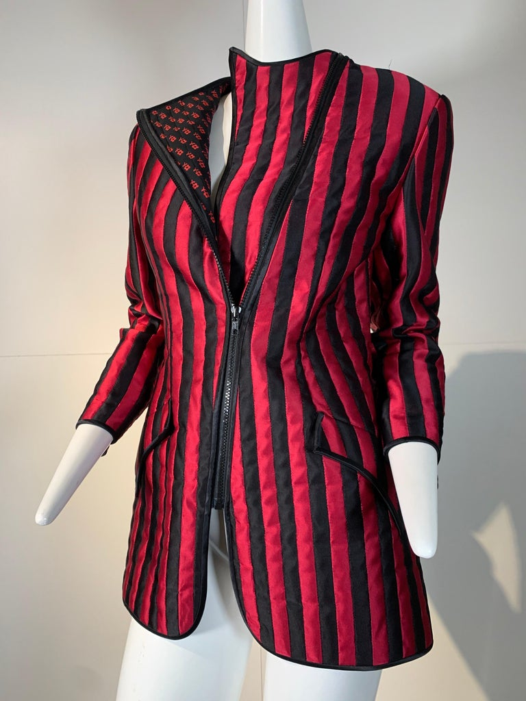 1980s Geoffrey Beene red and black satin pieced stripe smoking-style jacket with asymmetrical zipper:  zipped completely, the collar pieces disappear for a clean sleek look. When half-way zipped, the placket pieces fold back to form floral print