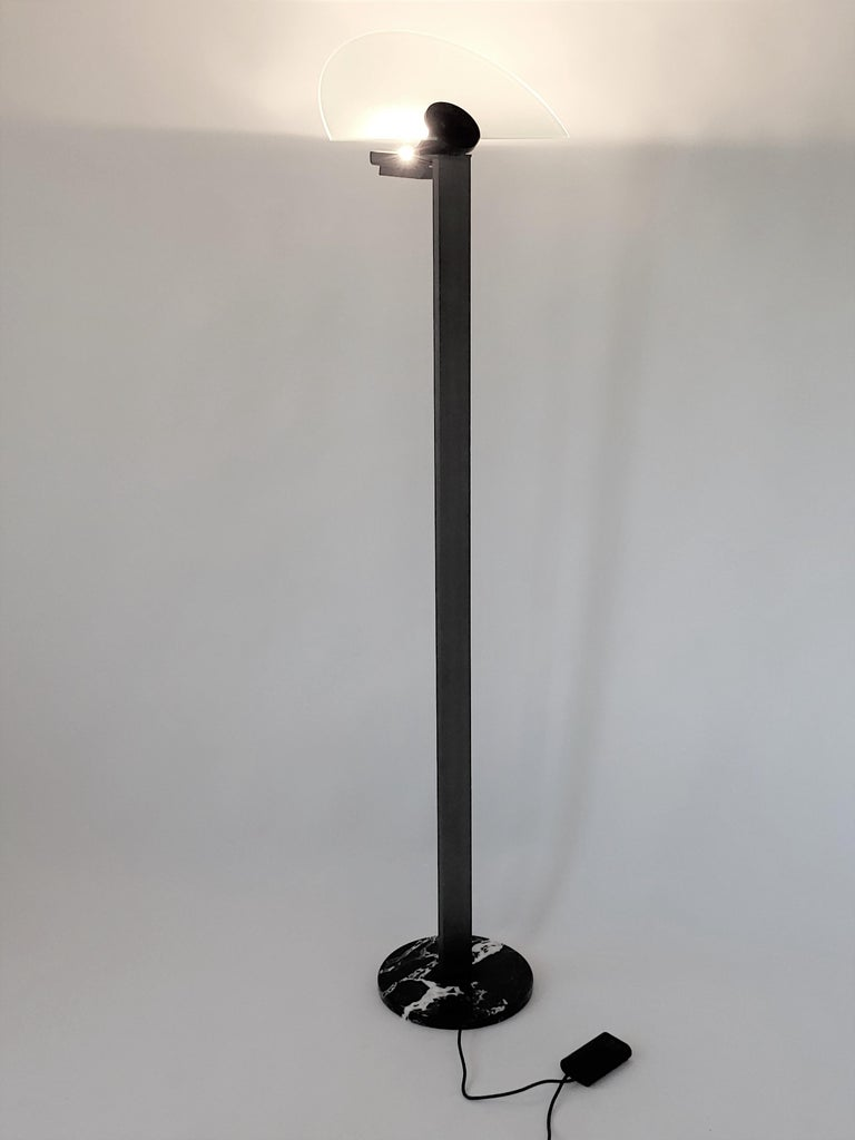 Hans Von Klier worked with Ettore Sottsass from 1960-1969, hence the Memphis style of this lamp .   Made of extruded aluminium with a durable charcoal grey electroplated finish.  Measure 83 inches high.   Etched glass shade and light bulb