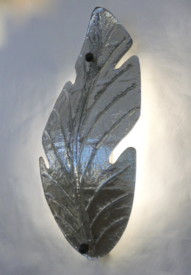 1980s vintage organic modern pair of huge Venetian leaf-shape Murano glass wall lights with Art Deco Design, stunning large size, decorated in silver finish overlaid in clear glass that creates a mirror like surface handcrafted with a tracery