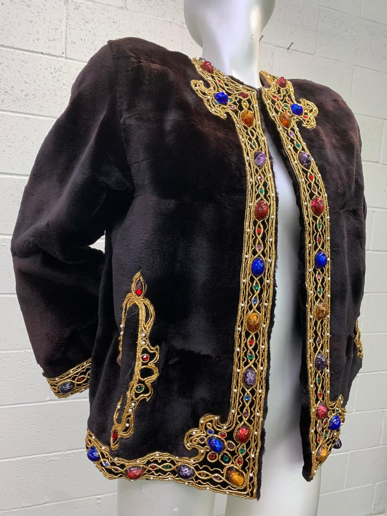 1980s Oscar de la Renta sheared mink fur jacket with bejeweled gold braid trim:  Boxy cut jacket features cabochon glass faux jewels set with faux pearls and gold braid lining the hem, front placket and slash pockets. Lush sheared ebony mink is so