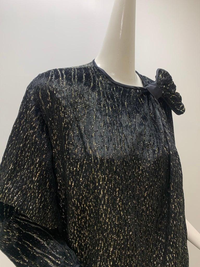 A 1980s Schiaparelli label, black and gold lame