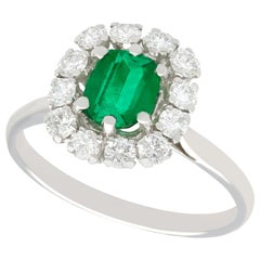1980s 1.33 Carat Emerald and Diamond Gold Cluster Ring