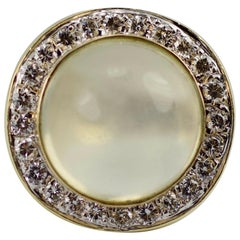1980s 14 Karat Gold Moonstone with a Halo of Round Diamonds Euro Shank Ring