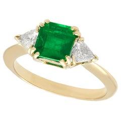1980s 1.65 Carat Emerald and Diamond 18k Yellow Gold Trilogy Ring