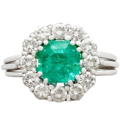 1980s 1.94 Carat Emerald and Diamond White Gold Cluster Ring