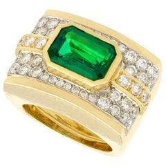 1980s 3.50 Carat Emerald and 1.72 Carat Diamond Yellow Gold and Platinum Ring
