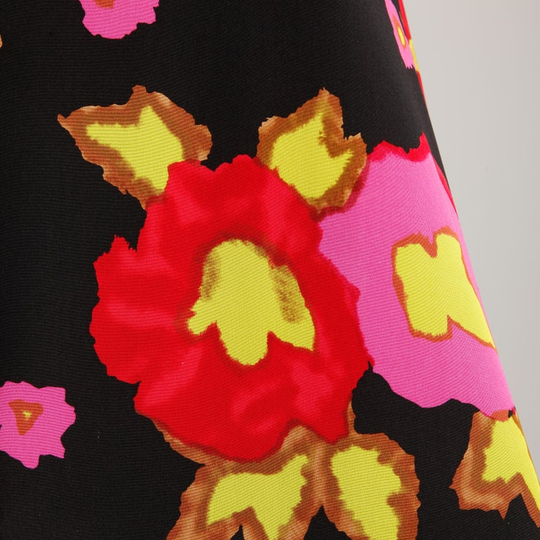 Darling vintage Arnold Scaasi silk dress in a vibrant floral print. Fully lined with rear zip and hook closure and a structured front box pleat. 100% silk with 100% acetate lining. The marked size is 6, and the dress fits true to size. The bust