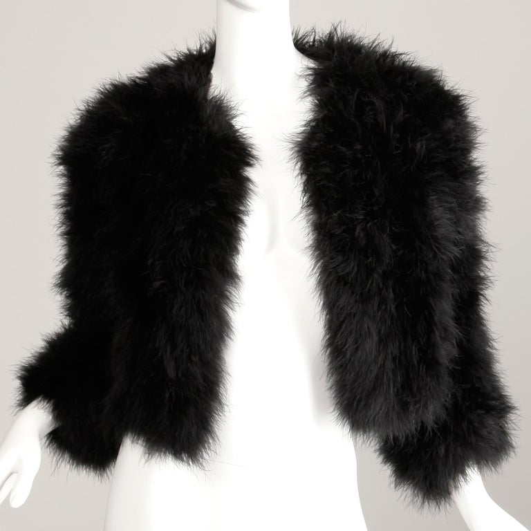 Gorgeous vintage 1980s black marabou feather jacket by Adrienne Landau. Unlined with front hook closure. 100% Marabou feathers. The marked size is