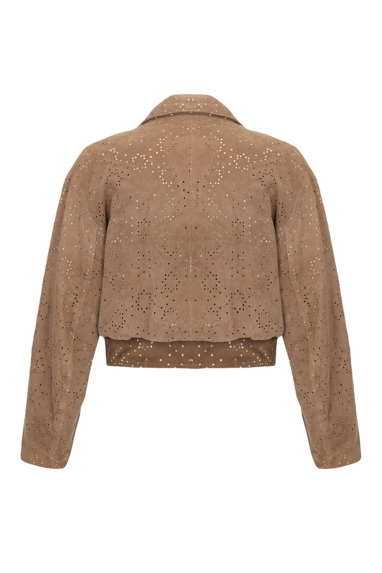 This desirable 1980s tawny lamb skin jacket with laser cut detail is by French designer Alaïa and is in superb vintage condition. Alaïa established his ready to wear label in 1980 having previously worked at Mugler, Guy Laroche and Dior. One of his