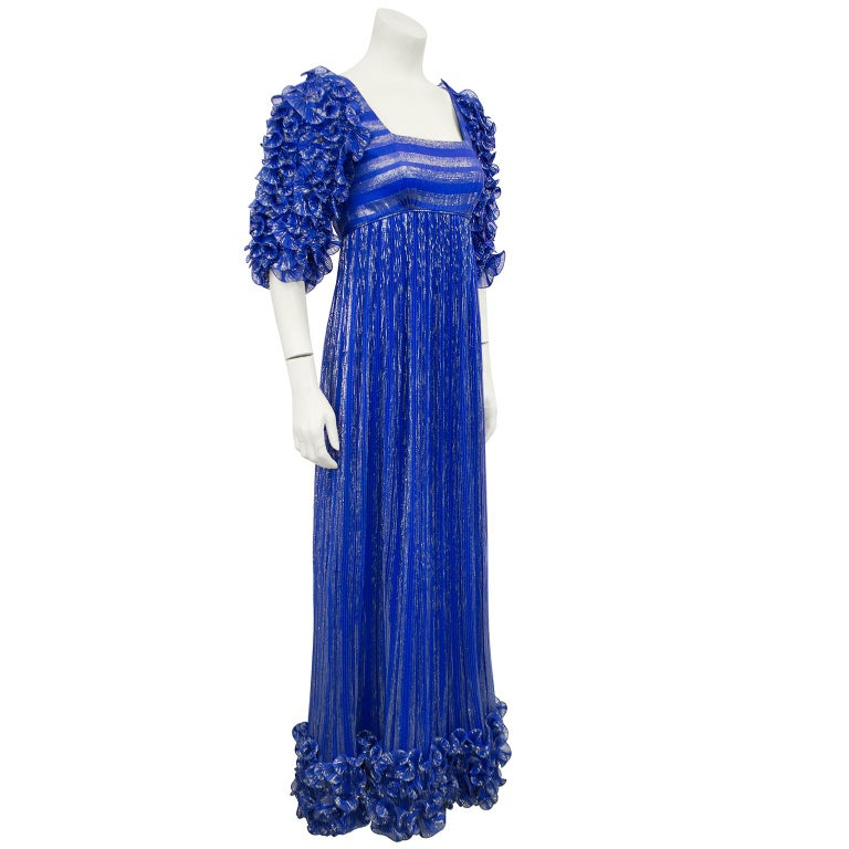 Dynasty era late 70's early 80's 's Alfred Bosand empress Josephine style gown. Plisé pleated origami style short sleeves with matching detail above the hemline. Square low cut neckline, column style skirt. Fully lined in royal blue. The royal blue