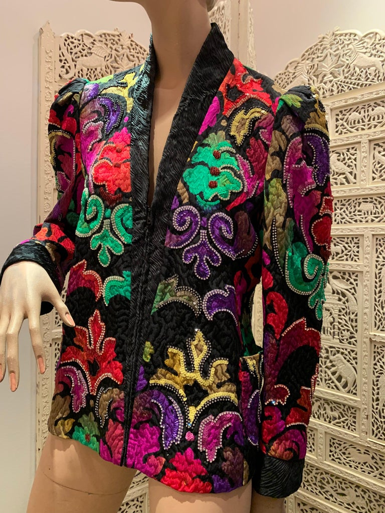 1980s Amen Wardy multi-color silk matelasse evening jacket in a rinceau pattern embellished with sequins and rhinestone trim and styled with a great puffed shoulder silhouette. Fully lined. Zippered front.