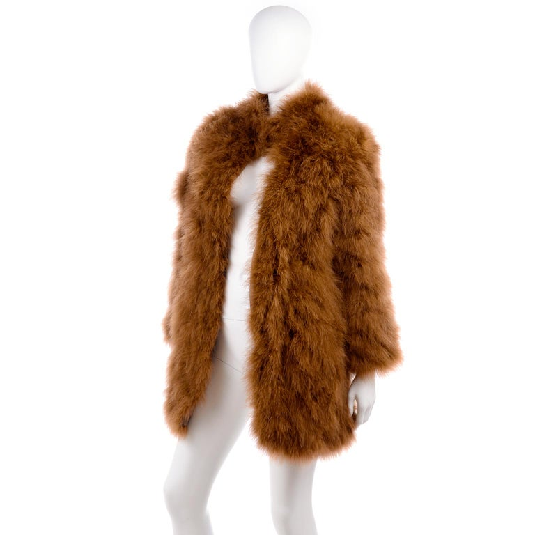 This coat is a so stunning! Covered in brown ostrich feathers, this vintage Andre Laug jacket from late 1970's or early 1980's makes an effortless statement. The layers of feathers give it tons of movement when you walk, and it would look fabulous