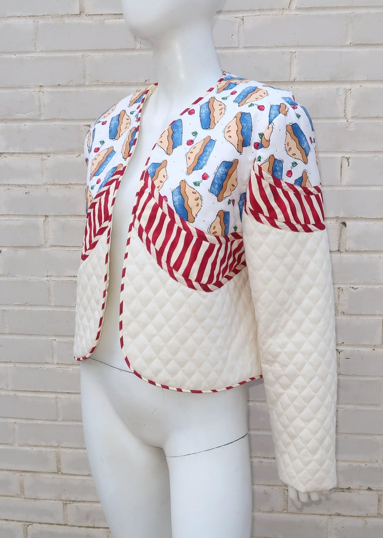 This fun 1980's jacket by Marie Studer Designs is the epitome of an all-American look with a cherry pie motif and red, white and blue color combination.  The California based artist, Marie Studer, is a native of Georgia with a storied history of