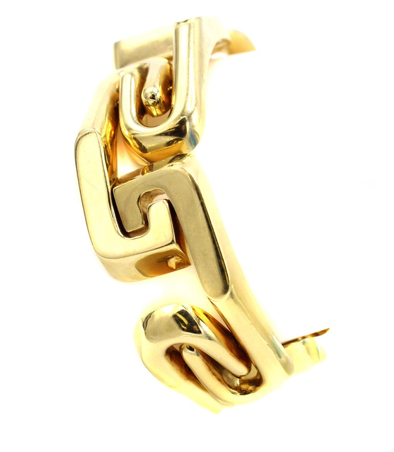 Uniquely designed and masterfully hand-crafted this chic bracelet has 7 flexible elements of high polished gold at various angles giving an interesting three-dimensional appearance. Each element has an angled rounded tube connecting to a flatter