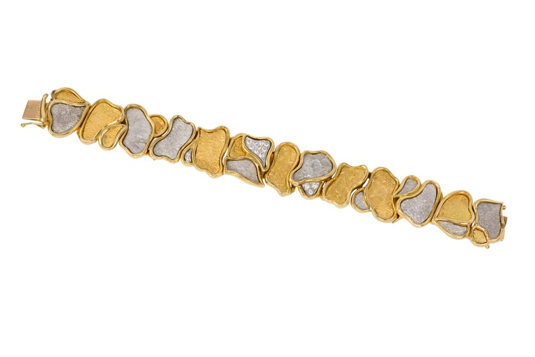 A diamond and 18 karat white and yellow gold bracelet, by Swiss-Spanish jeweler Augustin Julia Plana, c. 1980. The bracelet is stamped design Julia-Plana  S 750.   Julia-Plana's unique and highly regarded designs can be found in the collections of