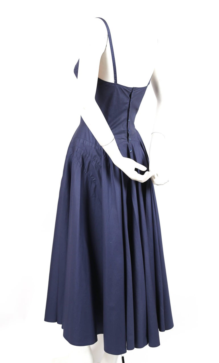 Blue cotton bustier dress with amazing seams and full button back designed by Azzedine Alaia dating to the 1980's. Labeled a French size 38 however this would best fit a modern day French 36