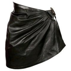 1980's AZZEDINE ALAIA draped black mini skirt with side buckle