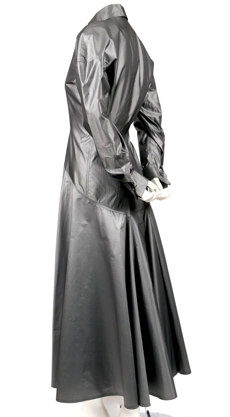 Gunmetal-grey silk dress with extensive seams and French cuffs designed by Azzedine Alaia dating to the 1980's. Dress is labeled a French size 38. Approximate measurements: bust from armpit to armpit 36