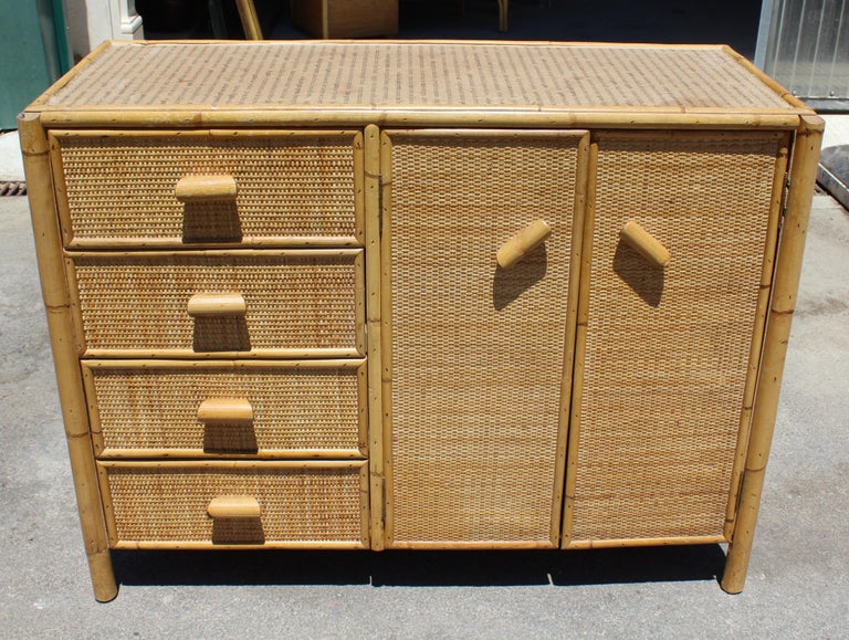 1980s bamboo and rattan chest with five drawers and two cabinet doors.