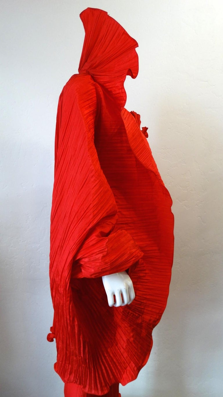 Make A Statement With This Amazing Piece! Circa late 1980s, this incredible Bernard Perris vibrant red pleated silk crepe cape features an extravagant Elizabethan high standing collar and a ruffled hem all throughout. The high standing collar