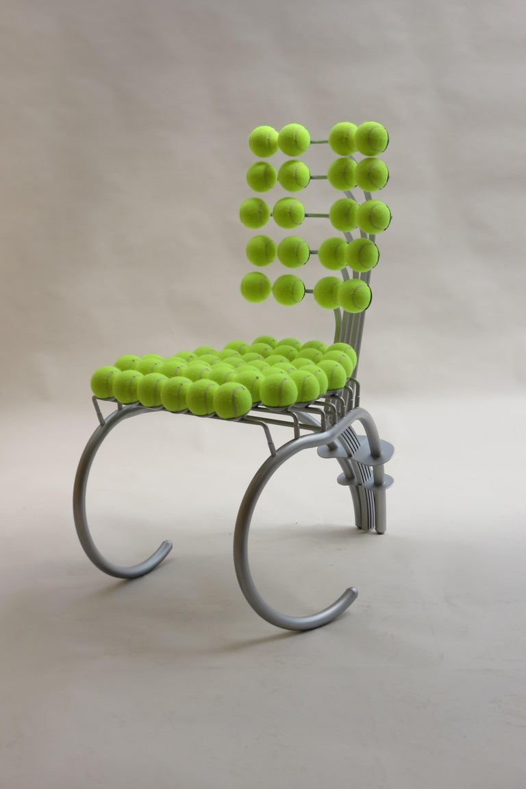 A bespoke chair made from steel and tennis balls. Believed to have been removed from Wimbledon Tennis Club when it was refurbished.  The chair is very well made and has a five leaf spring action to the back.  The tennis balls have been replaced and