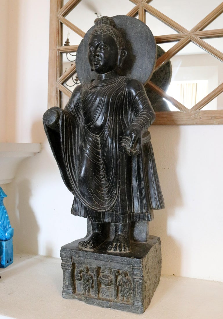 Indian 1980s Black Marble Hand Carved Standing Buddha Sculpture with Relief on the Base For Sale