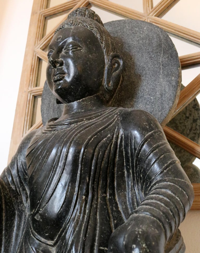 Hand-Carved 1980s Black Marble Hand Carved Standing Buddha Sculpture with Relief on the Base For Sale