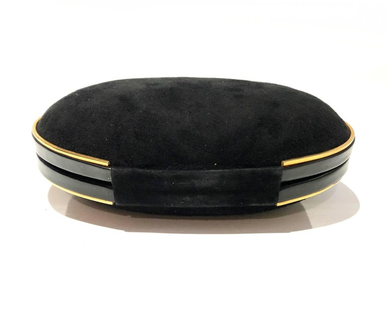 Women's or Men's Gucci 1980s Black Vintage Gold oval shaped clutch bag For Sale