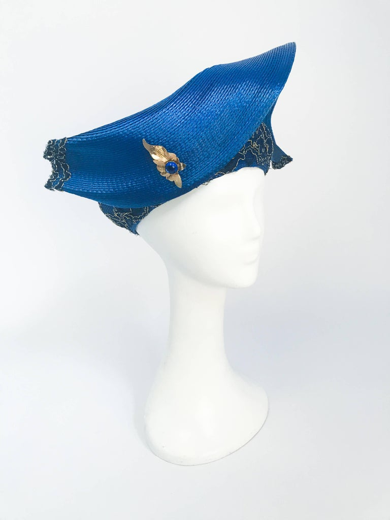 1980s Blue and Gold-tone Structured Hat. Blue woven hat with structured accent and gold-tone and lace embellishment. 21+ inch circumference (size small).