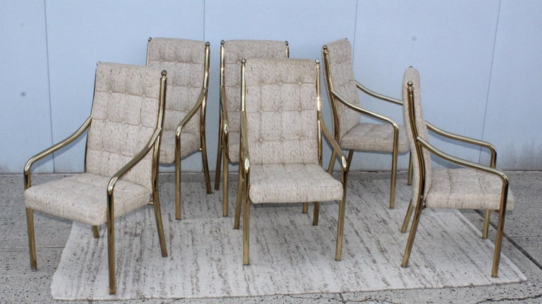 1980s modern very heavy metal with dining chairs with brass finish. In vintage original condition with original upholstery. With minor wear an patina to the brass.
