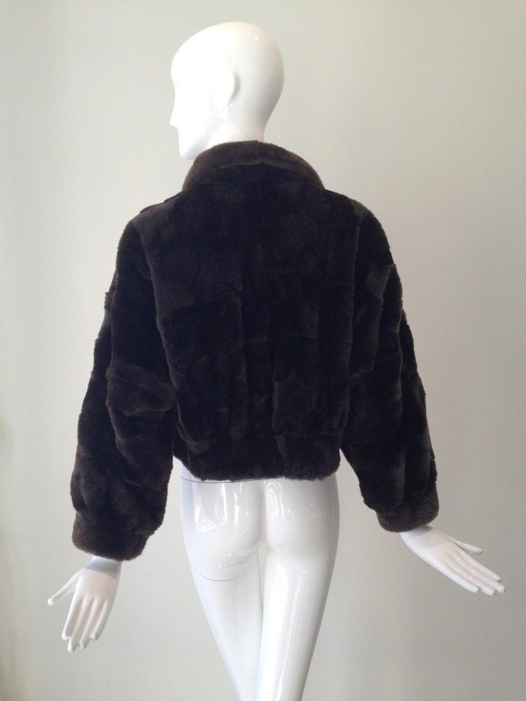 Brown Nutria fur jacket. 3/4 Sleeves. Fur is in excellent condition Size : 4-6