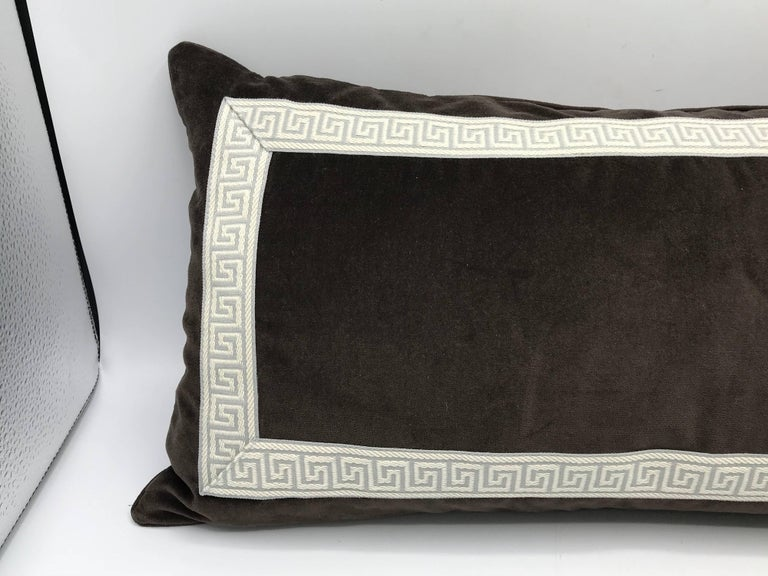 Listed is a gorgeous, 1980s brown velvet lumbar/throw pillow with a gray and white Greek key banding. Zipper closure, down-fill insert. Dry clean only.