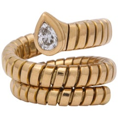 1980s Bvulgari Tuboga Serpenti Coiled Diamond and Gold Stretchable Snake Ring