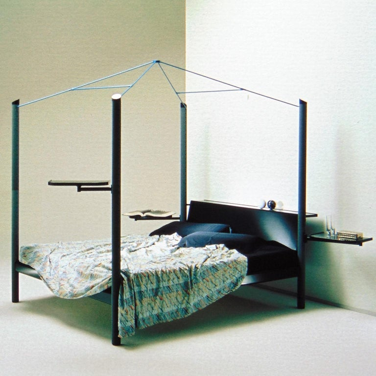 An unusual canopy bed, named Fauno, manufactured by Sormani in very dark green (almost black) glossy lacquer, with 4 columns in grey nextel and a metal canopy in light apple green. The bed has multifunctional structures all around: two trays that