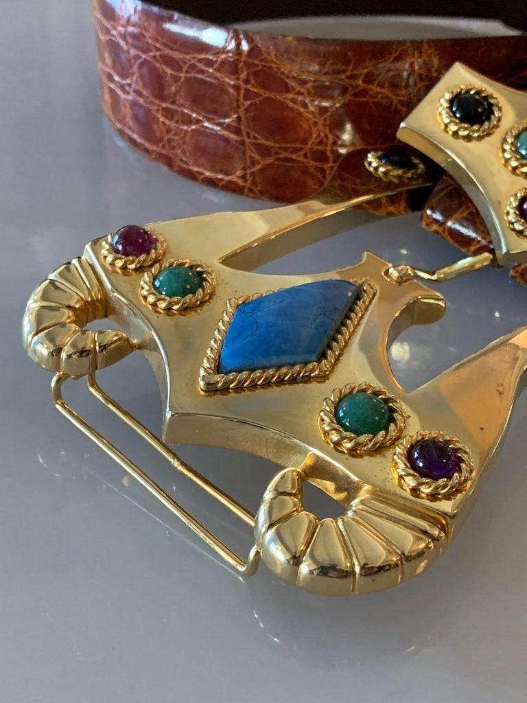 1980s Caryn Suzann Genuine Alligator Belt Featuring A Massive Etruscan-Inspired Gold Tone Buckle With Semi-Precious Stones.