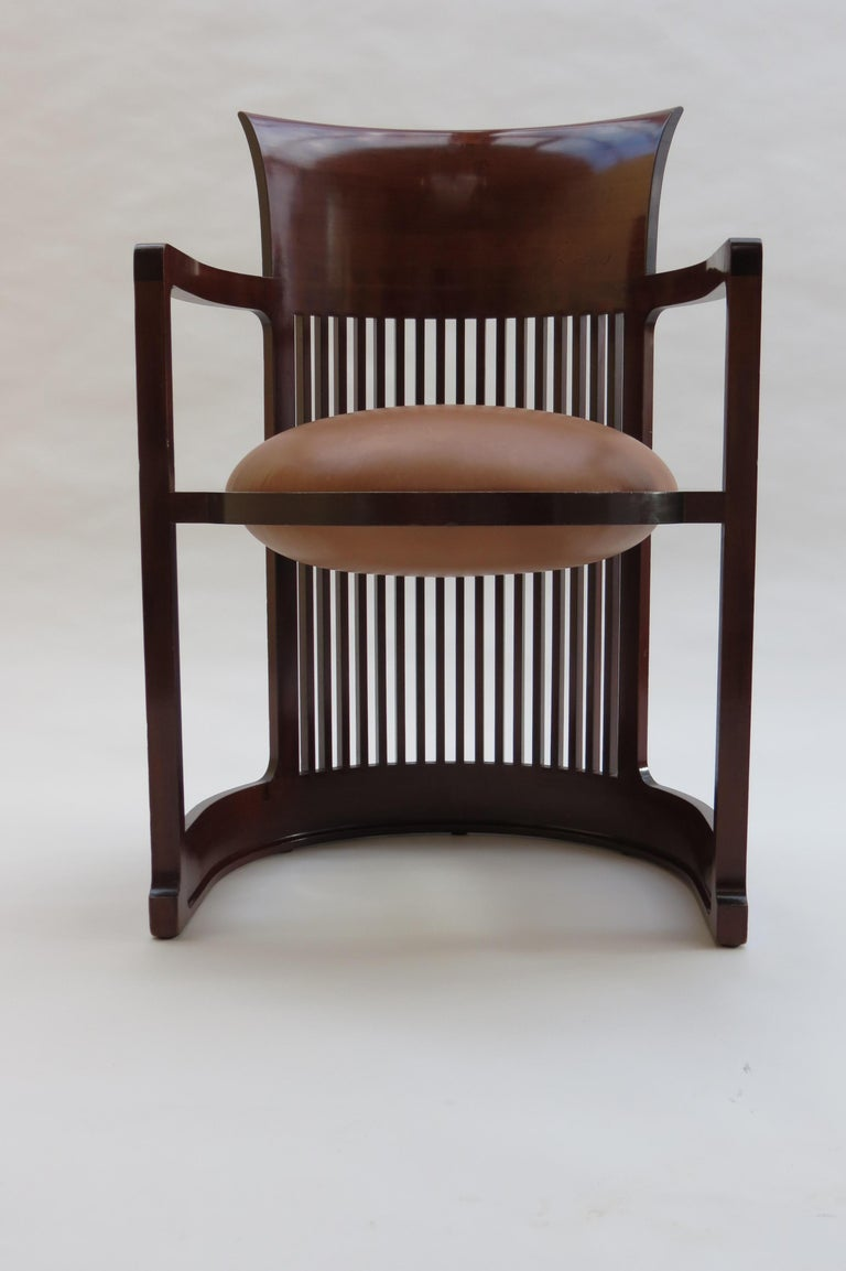 A Taliesin Barrel chair, designed by Frank Lloyd Wright and produced by Cassina.