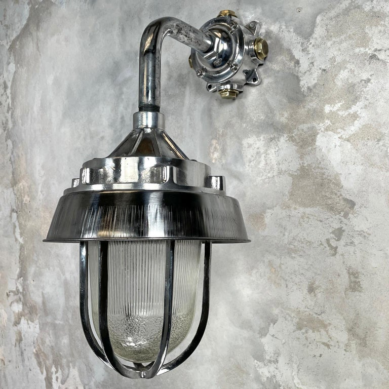Industrial 1980's Cast Aluminium Cantilever Wall Lamp Reeded Glass, Steel Shade & Cage For Sale
