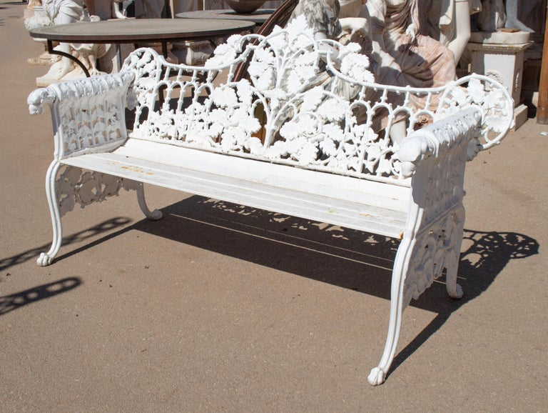 1980s cast aluminium solid metal white garden bench with grapes, flower garlands and animal head on armrests.