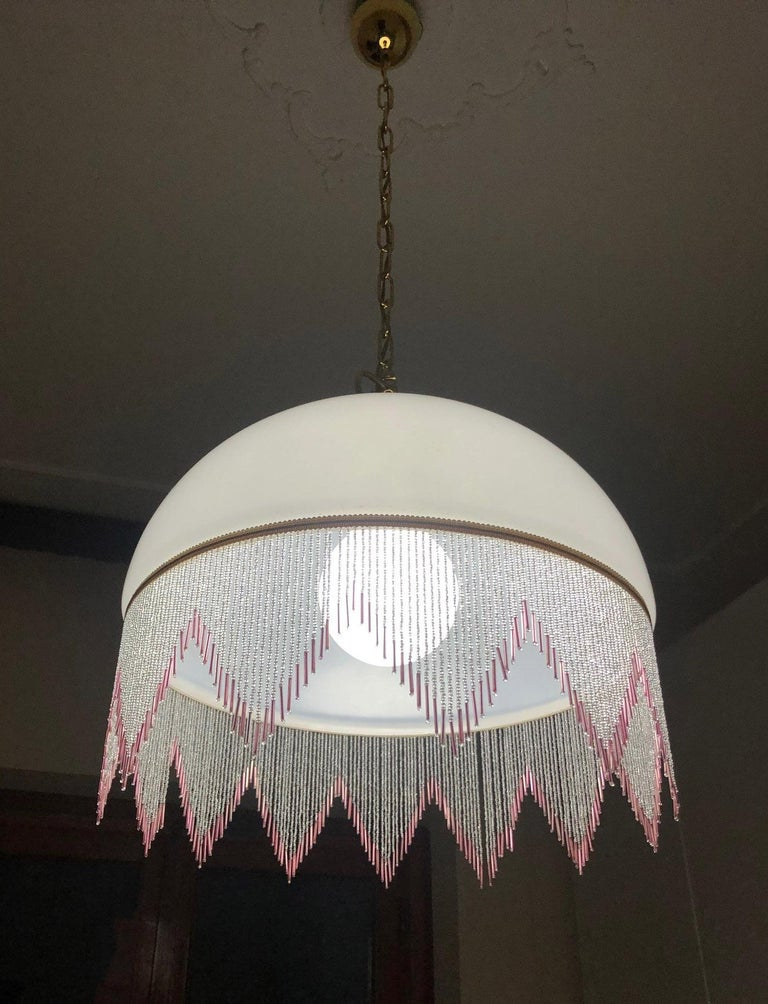 1980s glass chandelier in satin white color, with one light, special pink hanging decorations Size cm.: 45 diameter, height 105.