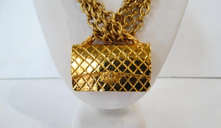 The Most Adorable Chanel Necklace Ever! Circa late 70s/early 80s, this gold plated Chanel Necklace features a multi strand chains, a trigger closure and a choker style. Includes a detailed classic 2.55 handbag charm making this fashion piece a real