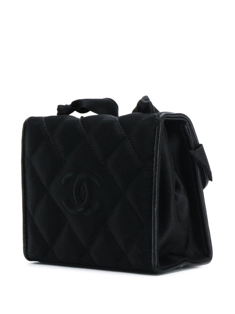 The silk satin 80's bow detail bag from Chanel features a shoulder strap, a foldover top with magnetic closure, a main internal compartment and an internal slip pocket.   Please note that the bag shows lights signs of wear at lining and at bow. Made
