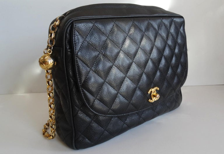 The Chanel Bag Of Your Dreams Is Here! Circa late 1980s, this classic bag features gold hardware and beautiful black caviar leather. Font face of bag includes a quilted textured signature CC mademoiselle turn lock which opens to reveal a flat