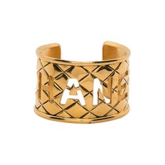1980s Chanel Gold Plated Large Logo Cuff