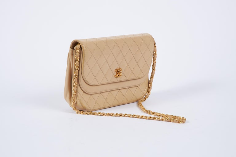 Chanel vintage 80s beige lambskin double flap with gold tone hardware. Comes with original dust cover.