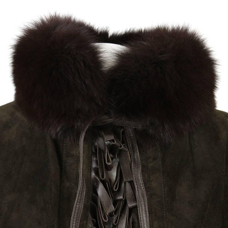 Beautiful Christian Dior Boutique Cuirs greenish brown suede cape Coat trimmed with fox brown fur on the collar and the bottom, and fringed along the edges with brown leather listels. The item is entirely opened on the front, the only closure is a