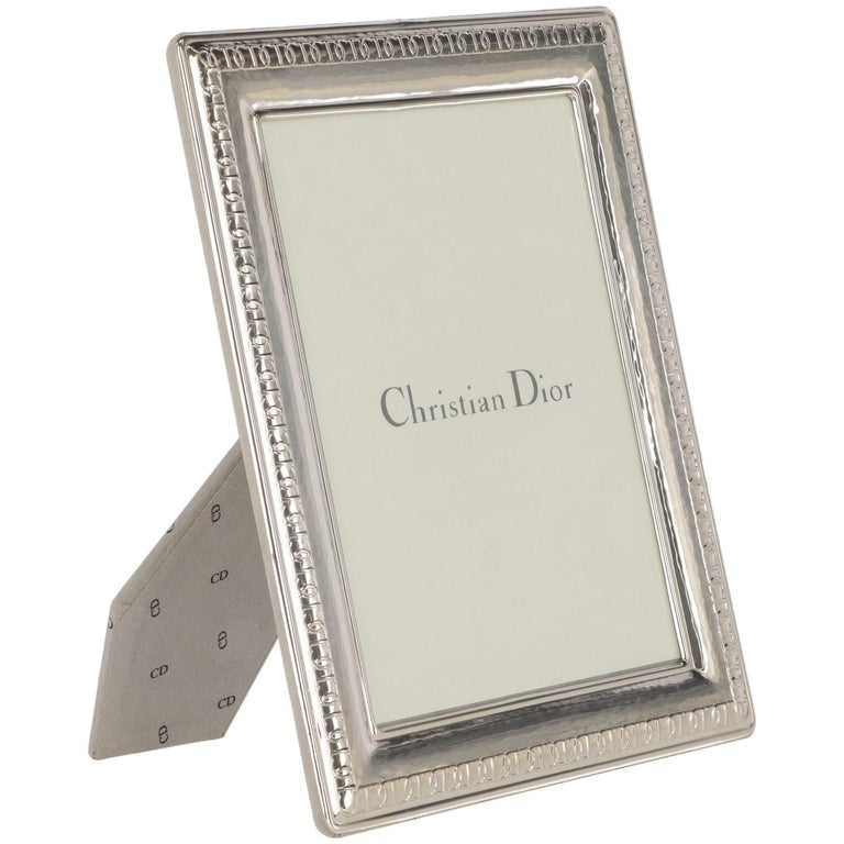 The precious Christian Dior frame is in sterling silver with a protective-tarnish- proof coating guarantee high quality, and lasting splendor. All the frame is branded with CD logo. The original box and the original soft dust -bag is included. There