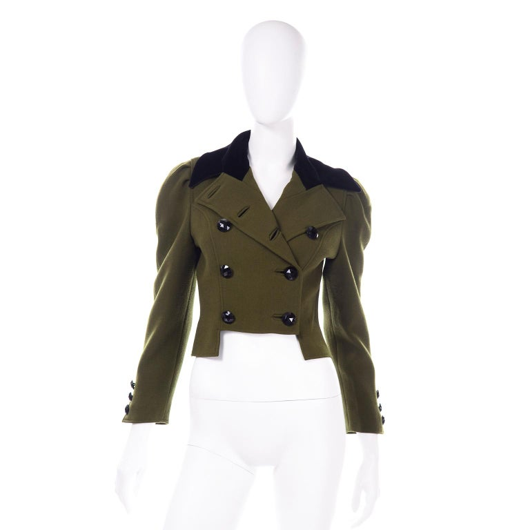 This vintage Edwardian inspired Christian Lacroix jacket is incredible! We love the rich  green wool fabric and pointed black velvet collar. The jacket is double breasted with black faceted buttons and smaller of the same buttons on the cuffs of the